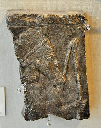 History of archery - Archer wearing feather headdress. Alabaster. From Nineveh, Iraq. Reign of Ashurbanipal II, 668-627 BCE. The Burrell Collection, Glasgow, UK