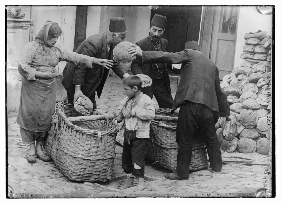 Armenian refugee women and child getting food relief