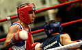Army Capt. Boyd Melson throws a right hook against H. Rawshan of Uzbekistan during the Military World Games Boxing competition.JPG