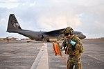Australian soldier preparing a fuel line to a RAAF C-130J in 2018.jpg