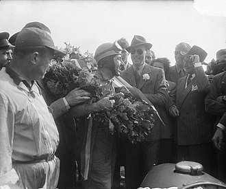 1953 Dutch Grand Prix - Ascari after winning the Grand Prix with Prince Bernhard of Lippe-Biesterfeld to his left.
