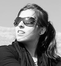 Iranian girl using sunglasses in northern moun...