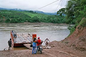 Barge over the Huallage in Peru.jpg