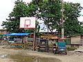 Basketball hoop and tricycles in the Philippines.JPG