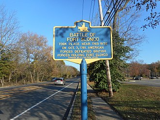 """Fort Salonga, New York - Historic marker for the """"Battle of Fort Slongo"""" along eastbound NY 25A."""