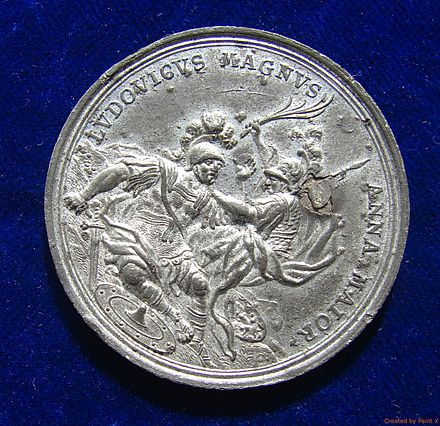 German war propaganda medal 1706. The obverse shows Louis XIV as Roman warrior being subdued by Queen Anne as Minerva. Battle of Ramillies & Seizure of 12 Flanders Towns in the War of the Spanish Succession. Medal 1706. Obverse.jpg