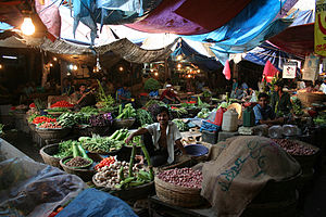 Bangladeshi cuisine - A kitchen market bazaar in Bangladesh, displaying a wide range of vegetables and fruits grown in the country's fertile plains