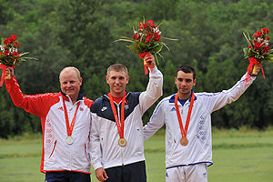 2008 Summer Olympics medal table - From left to right: Tore Brovold from Norway (silver), Vincent Hancock from USA (gold) and Anthony Terras from France (bronze) with the medals they earned in Men's skeet shooting