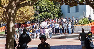Milo Yiannopoulos - Yiannopoulos (seen from a distance) greets supporters on the steps of Sproul Hall, UC Berkeley, 24 September 2017