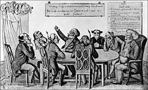 Menn som sitter rundt et bord.  De fleste av dem er munnkurv, noen er også kneblet, noen har bind for øynene, og noen har ørene dempet.