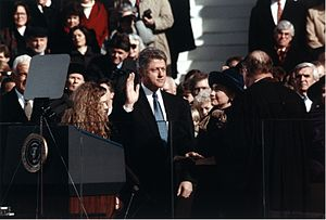 English: Bill Clinton, standing between Hillar...