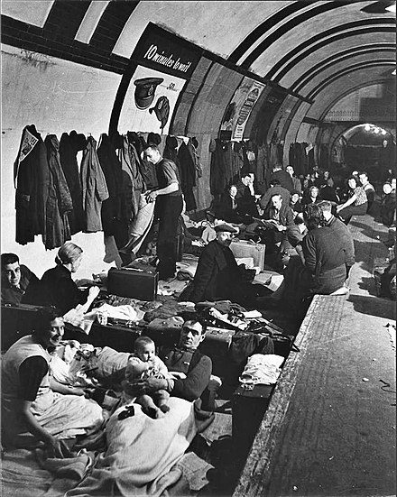 Londoners shelter from an air raid in an Underground station. Blitz West End Air Shelter.jpg