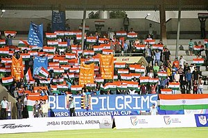 Blue Pilgrims, 2018, displaying tri-colour and their banners Blue Pilgrims at Mumbai 2018 to support India national football team.jpg
