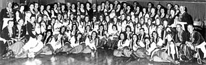 "Ukrainian Australians - Ukrainian choir ""Boyan"" — director Vasyl Matіash (top row — centre), with the ""Ukrainian Folk Ballet"" — musical director and choreographer — Natalia Tyrawsky (top row — centre). Photo early 1970s, Sydney"