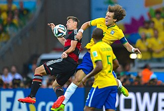 Brazil v Germany (2014 FIFA World Cup) - Brazil's captain David Luiz (back centre) led a defence that was incapable of stopping the Germans from scoring four goals in six minutes, starting with Miroslav Klose's (left) strike in the 23rd minute.