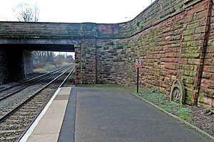 Hough Green railway station - Image: Bridge and stone, Hough Green railway station (geograph 3819562)
