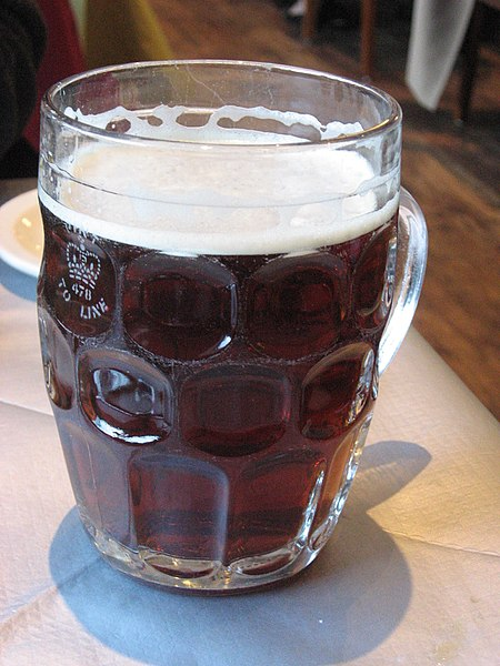 File:British dimpled glass pint jug with ale.jpg