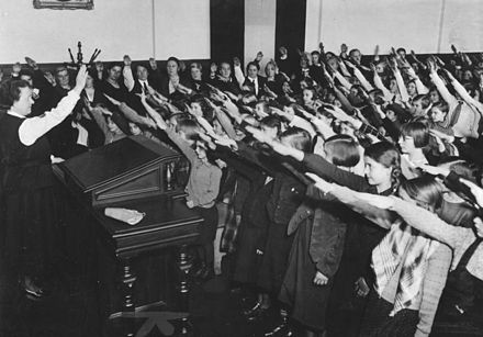 The Nazi salute in school (1934): children were indoctrinated at an early age Bundesarchiv Bild 183-2007-0329-501, Reichsgrundungsfeier, Schulklasse.jpg