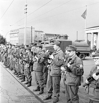 Berlin Wall - East German Combat Groups of the Working Class close the border on 13 August 1961 in preparation for the Berlin Wall construction.