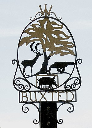 William Levett (Rector of Buxted) - Village sign for Buxted, East Sussex, commemorating casting of first iron muzzle-loading cannon in England, 1543
