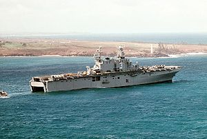 USS Belleau Wood prepares to receive a Marine landing craft