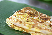 The final presentation of Roti Canai on banana leaf