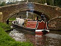 Canal boat passes Milford (Bridge 105), Staffs and Worcs Canal,Staffordshire. - geograph.org.uk - 1279708.jpg