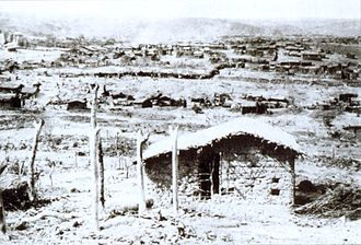 War of Canudos - A view of the village of Canudos. Typical constructions such as that in the foreground were very basic, made of mud and straw