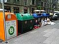 Cardboard overflows from recycling bin onto sidewalk (18187694083).jpg