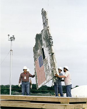 Cape Canaveral Air Force Station Launch Complex 31 - A section of debris from Challenger space shuttle being lowered into a missile silo near the Kennedy space center.