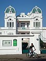 Club Cienfuegos and Cyclist - Cienfuegos - Cuba (5289929832).jpg