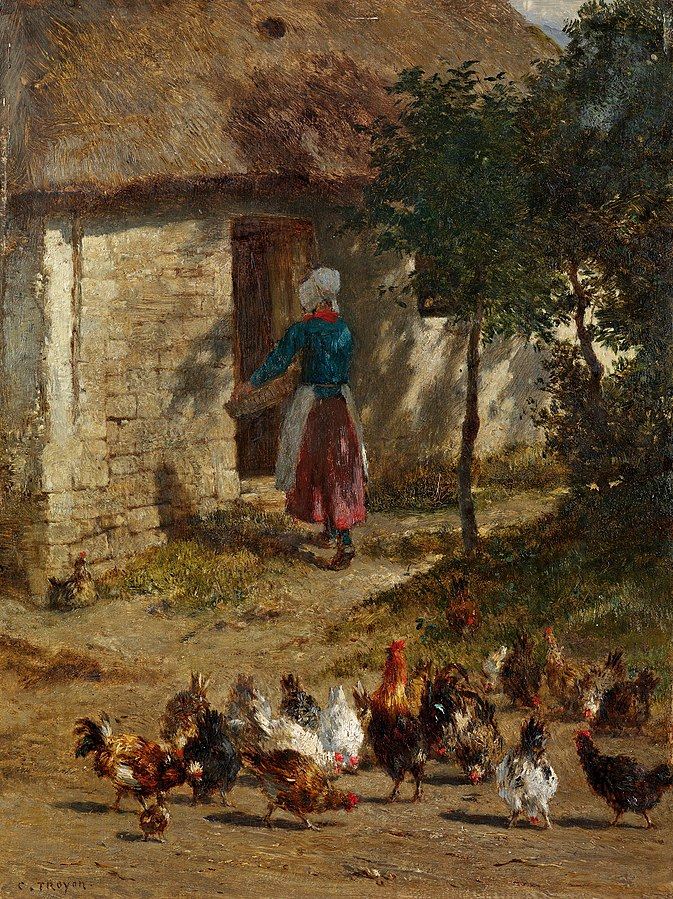 Chickens in front of a farmhouse