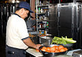 Contract worker prepares food at Guantanamo -c.jpg