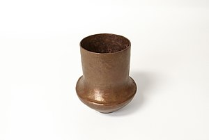 Raising (metalworking) - This is a copper vase formed using the process of raising.