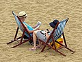 Couple with deckchairs at Viking Bay, Broadstairs, Kent, England.jpg