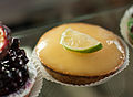 Custard tart topped with a slice of lime at Aurore-Capucine.jpg