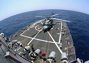Helicopter deck - A U.S. Navy SH-60 Sea Hawk helicopter prepares to lift off from the flight deck of an Arleigh Burke Class destroyer.