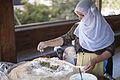 DRUZE WOMAN PREPARING A TRADITIONAL DISH PN12IGA02320 ITAMAR GRINBERG IMOT (14033392419).jpg