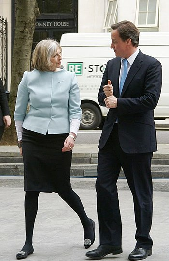 Prime Minister David Cameron is met by Theresa...