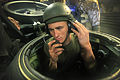 Defense.gov News Photo 100628-M-9093S-008 - U.S. Marine Corps Lance Cpl. Ruben Andrade performs a communications check in an AAV-7A1 amphibious assault vehicle in the well deck of the.jpg