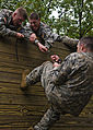 Defense.gov News Photo 100914-D-8594F-211 - U.S. soldiers competing in the Army Warfighter Challenge attempt to pull their comrade over a fifteen foot wall at the obstacle course on day two.jpg