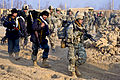 Defense.gov News Photo 101228-A-8192Q-002 - U.S. Army soldiers and Afghan police move out on a foot patrol in the Isa Khan region of Afghanistan s northern Kunduz province on Dec. 28 2010.jpg