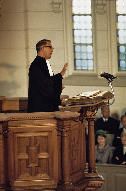 A Reformed Christian minister preaching from a pulpit, 1968