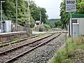 Eggesford railway station, Tarka Line, South Devon - view towards Crediton with level crossing.jpg