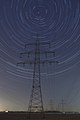 Electricity pylon star trails BW2016.jpg
