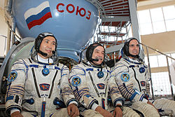 Expedition 36 backup crew members in front of the Soyuz TMA spacecraft mock-up in Star City, Russia.jpg