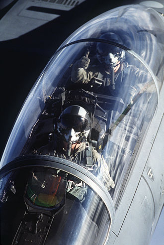 Weapon systems officer - F-15E cockpit view from tanker, pilot and WSO visible