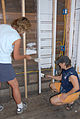 FEMA - 30615 - Painters sealing flooded wood wall.jpg