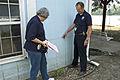 FEMA - 30620 - FEMA field workers examine a structure.jpg