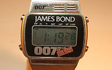 "An oblong-shaped digital watch. Above the face is the name ""JAMES BOND"". Below the face are a stylised ""007"" and the logo of the film, ""FOR YOUR EYES ONLY""."